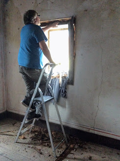 repairing a rotten window frame. Renovation of an old manor house portugal