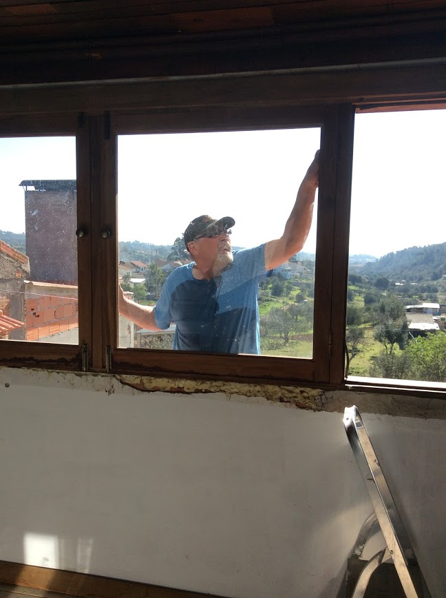 Installing new windows. Renovating an Old Manor House. Portugal